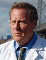 John Heard as Dr. Alan Shearson